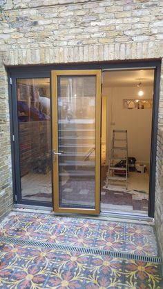 Solarlux SL67 Bi-Fold Doors multi-laminated wood profiles with ventilated aluminium shells on the outside. 3 panel set opening right when viewed from inside, stacking outside. Outside colour is anthracite grey with light oak on the inside.