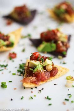 """""""Spicy Ahi Tuna Avocado Tartare Bites are easy to make for a healthy delicious appetizer with all the flavors of a spicy tuna roll served on tortilla chips. Perfect for parties and celebrations. Cucumber Appetizers, Cucumber Bites, Bite Size Appetizers, Quick And Easy Appetizers, Yummy Appetizers, Yummy Snacks, Appetizer Recipes, Yummy Food, Appetizer Dinner"""