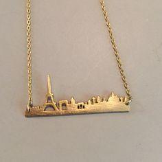 Paris skyline necklace Really cute gold tone Paris skyline necklace. It's on a 16 inch chain. Jewelry Necklaces