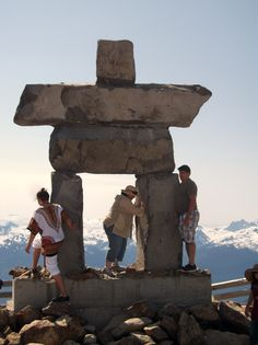 The Inukshuk at Whistler Peak. Not sure where these people are from. The lady worked really hard to get up there, so I though worth a picture as it didn't seem like we would get up there ourselves.