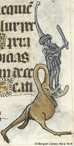 Fantastic bird with long neck and head bent to its back; and man, wearing tall pointed hat, holding club in right and small shield (?) in left hand, standing on tongue of fantastic two-legged animal | Book of Hours | Spain, perhaps Burgos or Segovia | 1465-1480 | The Morgan Library & Museum