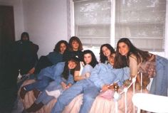 This photo was taken in 1994 during a sweet 16 party. Nobody has any clue who the shrouded girl in the corner is.