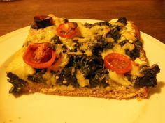 Over heerlijke dinkelmeel-pizza met roomkaas en spinazie