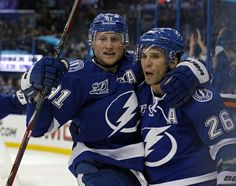 Steven Stamkos and Martin St. Best team up of all time! Nhl, Tampa Bay Lighting, Steven Stamkos, Who Plays It, Martin St, Sports Fanatics, World Of Sports, Hockey Teams, Thunder