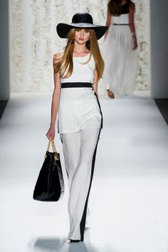 Trend Alert... Wide Brim Hat and Black  Her pants are long and lean...  Rachel Zoe Spring 2013