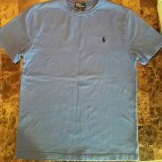 Boys Polo Shirt Boys Polo Shirt indigo blue color. Good condition but it has a small stain that is hard to see in center of chest area. Polo by Ralph Lauren Tops Tees - Short Sleeve