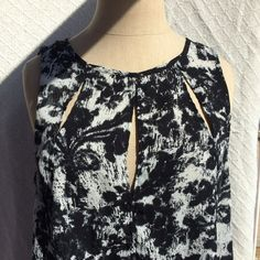 Black and white top. Urban Outfitters! Black and white top. Front slits giving a sexy look and a small one on the back! Never worn practically new and in perfect condition! Fast shipping! PRICE is NEGOTIABLE Urban Outfitters Tops