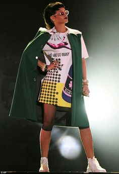 Rihanna wears a Raf Simmons menswear look for her Singapore F1 Grand Prix performance.