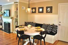 Built in dining room banquette, love  the wainscoting on the wall. Colors are good too.