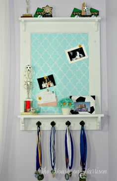 This is another thought of how to display trophies and medals, this time using a cork board on the back.  Can easily change the design to fit a boys room decor... by:DIY Trophy Display {& Pinboard} | House On Harrison