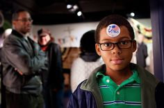 Noah Hope, 10, shows off his I Voted sticker during the children's mock Election Day at Madame Tussaud Wax Museum in Washington D.C.