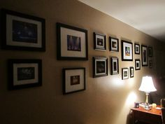 Black picture frames with white mats - This is my living room wall. I use these frames for concert and landscape pics I take. I usually print 5x7 and 8x10 photos.