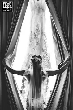 This is a great photo idea when wanting to showcase your wedding gown! Taken by Dennis Berti Photography. This is in the new collection of awesome #weddingphotography from Fearless Photographers.
