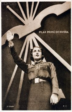 Pilar Primo de Rivera, sister of Jose Antonio Primo de Rivera and a leading Spanish fascist, gives a fascist salute in front of a giant Falange symbol of yoke and arrows, Spain, c. Meeting Room Booking System, Spanish War, Military Coup, Propaganda Art, Political Posters, Second World, Ms Gs, World History, People Around The World