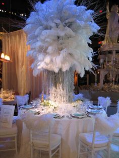 12 Ideas for Events with All White Decor    For Diffa's New York Dining by Design benefit in 2004, Robert Rufino of luxury jewelry company Tiffany crafted a towering centerpiece of white feathers and strings of iridescent beads. The structure was surrounded by small bunches of white flowers at the base. Other touches included marabou boas, which draped the backs of the chairs, and a white rug.
