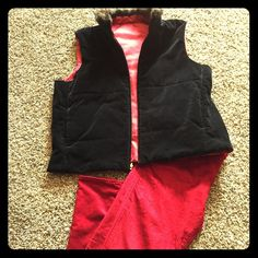 Black Velvet/Red Satin reversible vest This piece offers two different looks in one vest! One side is black velvet with pockets, front zip, faux fur collar, and pockets.  The reverse side is red/maroon satin with front zip, pockets,  and faux fur collar! This would be a perfect piece to pack for a trip! Perfect condition, non smoking home. Jackets & Coats Vests