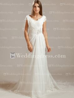 Modest wedding dress features in Lace with Tulle overlay. V-neckline and deep V-back is accented with Lace cap sleeves. Natural waistline is adorned with Lace and beading. Hidden back zipper with covered buttons. This dress is fully lined.
