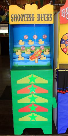 Shooting Ducks stand,  layers of cardboard where created, so the ducks and target could be staggered. A toy gun was hung from the top of the stand.