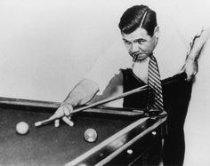 Babe Ruth playing billiards