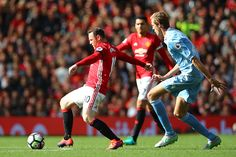 Wayne Rooney of Manchester United in action during the Premier League match between Manchester United and Stoke City at Old Trafford on October 2...