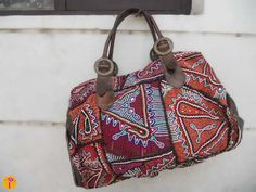 """I was so excited to show you this bag which i designed sometime back and it clicked to my mind when i wrote my previous post on """"hand embroidery : Gujarat """", what i love about these embroideries is the use of the vibrant colors and the mixed materials for the embroidery, also the interesting [...]"""