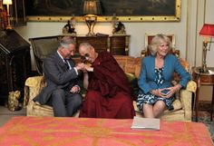 The Funniest Royal Pictures Of 2012: HRH Charles, Prince of Wales, The Dali Lama and Camilla, Duchess of Cornwall