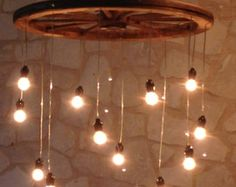 This is a 12 spoke wagon wheel chandelier made with quart size mason jars. There are 12 hanging lights, one from each spoke. The chandelier will come with a plug that can be easily removed to be wired directly into a power source.We recommend a professional electrician install the chandelier if you wish for it to be wired directly into a power source. The wagon wheel is 36 inches in diameter. This spiral design is approximately 4 1/2 feet long from the wagon wheel to the base of the lowe...