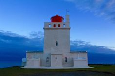 Dyrhólaey lighthouse is more than a century old and the country's only active lighthouse for visitors to sleep in - Perched on the cliffs at the southern most point of the country, in the surrounding area of Vík.