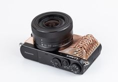 Werteloberfell Epochs, a series of 3d printed camera body parts inspired by art nouveau, modernism and the digital age, were presented to the public on Photokina in Cologne. The project pushes the boundaries of additive manufacturing in terms of detailing and material thicknesses.