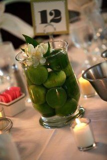 Wedding Reception Table Decorations Lime Centerpiece with a single flower from budgetdreamweddin. Lime Centerpiece, Non Floral Centerpieces, Wedding Centerpieces, Centerpiece Ideas, Floral Arrangements, Wedding Reception Table Decorations, Wedding Ideas, Wedding Stuff, Table Wedding