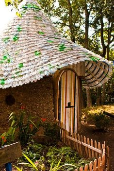earth home with empty plastic bottles for roof