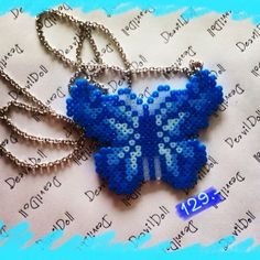 Butterfly necklace hama perler beads by deavildoll