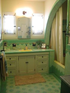 "1933 Spanish house, ""Shark Fin"" shower/bath and original vintage Art Deco tile, sink, fixtures, mirror by smhilbert."