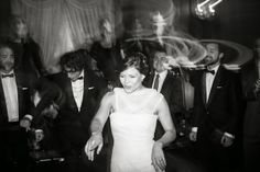 Black and white photo of bride dancing at the Union League of Philadelphia. The long exposer time allows for the light trails in the back ground. I think it adds to the energy of this photo.