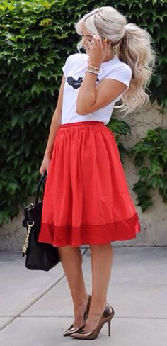 Girly look: Knee length skirt and curls.