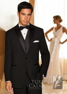 """The Black 'Avalon' Tuxedo features two vertical 1/2"""" satin inserts that frame up the wide satin lined peak lapels and top collar. Fashioned from tropical worsted wool, incorporating an updated slimmer fit and a two-button single breasted front, this style combines edge and class for a look that's perfect for any prom, destination wedding, or any """"dressy and fun"""" occasion headed your way! For more information on the 'Avalon' Tuxedo, check out the <a..."""