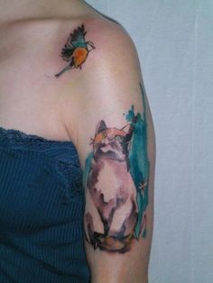 Funny cat and bird watercolor tattoo on arm for girls