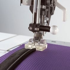 http://www.pfaff.com/en-US/Accessories/Invisible-Zipper-Foot  Instructions for use too!