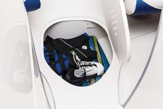 Ventilated in-floor wakeboard/ski storage compartment
