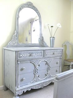 Chalk Paint by Annie Sloan, dresser and mirror. looks silvery blue. white base with lightly brushed blue. but probably it's simply white and the photo creates the silvery blue effect. #shabbychicdresserswithmirror #shabbychicdressersblue