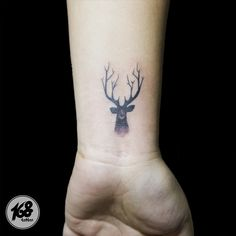 Deer tattoo small black and grey