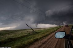 The twisters were photographed from inside Mr Christie's car after he drove towards the storm to try and photograph it