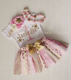 This listing is for a 3 piece Twinkle Little Star set! It includes our beautiful fabric tutu, fancy star headband and a birthday star themed bodysuit. A beautifully handcrafted girl's birthday outfit created using gorgeous fabrics, lace and sequins in pink, cream and gold. Your