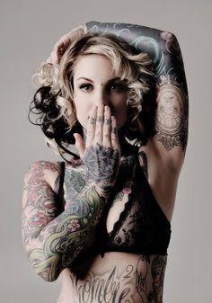 cute pose. intense tattoos!