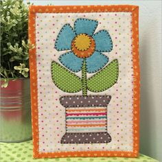 Spoolie Flower mug rug pattern by Stitches of Love Quilting