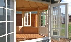This bright and airy EZ-Log gazebo has windows which swing open and latch closed.