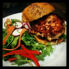 Homemade 9oz Turkey Burger with Basil-Goat Cheese Spread, Sun-dried Tomato Mayo and a Mixed Green Salad