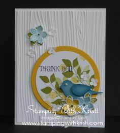 handmade thank you card  ... white background of embossing folder wood grain ...  layered circle with stamped and punched leaves ... two step bird nestling among die cut flowers ... beautiful card! ... Stampin'Up!