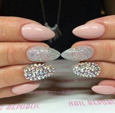pink, glitter, and rhinestone almond shape nails