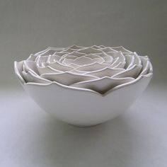 The organic shape of these Nesting Ceramic Lotus Bowls by Whitney Smith are gorgeous as a sculptural display piece and perfect for everyday use. Sturdily made with high-fire stoneware clay, a little c